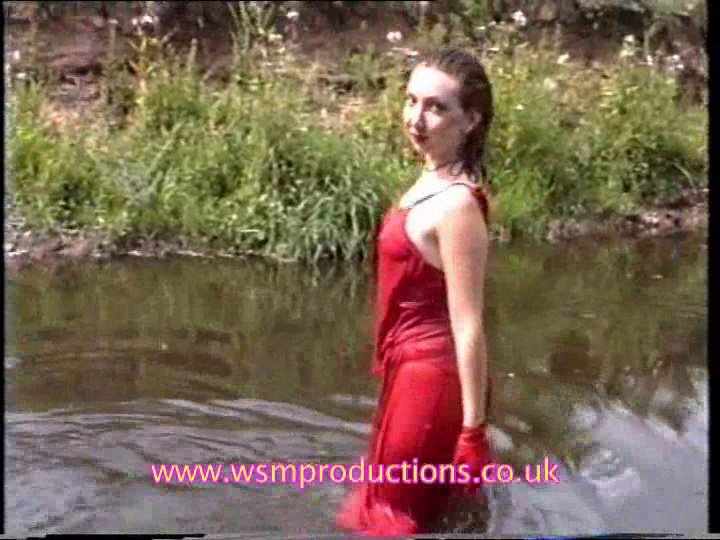MEL dressed in red in the river